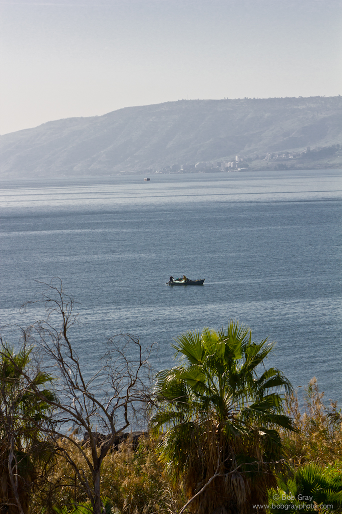 Fishermen pulling nets on the Sea of Galilee
