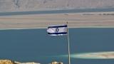 Israeli flag over Masada