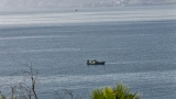 Fishermen pulling nets on the Sea of Galilee