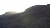 Sun setting behind cliffs at Mineral Beach